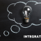 A metaphorical light bulb drawn on a blackboard with the caption 'Integration'